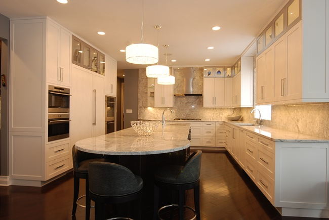 In This Chicago Kitchen Design, The Rounded Countertop Allows Room For  Three Comfortable Chairs To Be Placed Around The End.